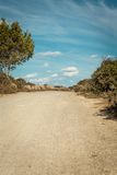 Empty road in sunlight blue sky destination Stock Photography