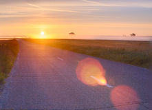 Empty road on sunrise. Bright sunrise over countryside empty road Stock Photography