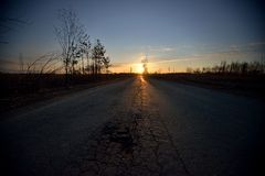 Empty road on sunrise Stock Photo