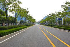 Empty road surface with modern city buildings background Royalty Free Stock Photo