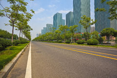 Empty road surface with modern city buildings background Stock Images