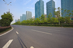 Empty road surface with modern city buildings background Stock Image