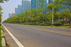 Empty road surface with modern city buildings background Stock Photos