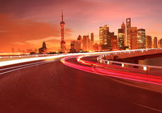 Empty road surface with Shanghai Lujiazui city buildings Dawn Stock Images