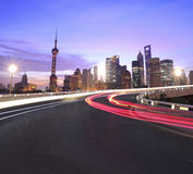 Empty road surface with Shanghai Lujiazui city buildings Dawn Stock Image