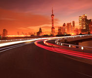 Empty road surface with Shanghai Lujiazui city buildings Dawn Stock Photography
