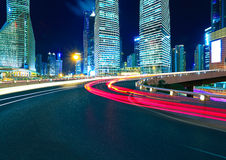 Empty road surface with shanghai lujiazui city buildings. Empty road surface with shanghai lujiazui modern city buildings backgrounds of night scene Royalty Free Stock Images