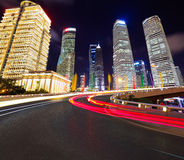 Empty road surface with shanghai lujiazui city buildings. Empty road surface with shanghai lujiazui modern city buildings backgrounds of night scene Royalty Free Stock Photography