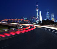 Empty road surface with Shanghai Lujiazui city buildings Night Royalty Free Stock Images