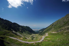 Empty road surrounded by mountains Royalty Free Stock Photo