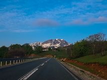 Empty Road to the Mountain stock photography