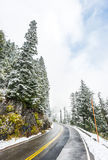 Empty road to the mountain with snow covered landscape in winter Royalty Free Stock Photos
