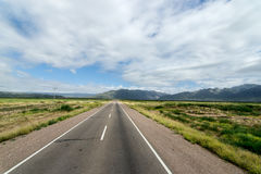 On the empty road to mountains. On the road to mountains Royalty Free Stock Photo