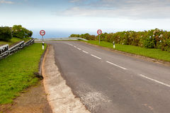 Empty road to the ocean. With two signs, San Miguel, Azores, Portugal Stock Images