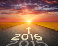 Empty road to upcoming 2016 at sunset Royalty Free Stock Images