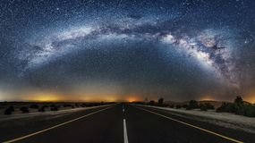 Empty road under starry skies
