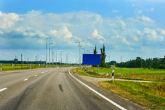 Empty road of Via Baltica E67 and beautiful clouds Royalty Free Stock Photography