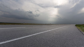 Empty road. View of empty grey road Royalty Free Stock Images