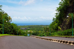 Empty road and views of the tropical island. And the sky Stock Photos