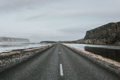 Empty road through waterway Stock Photo
