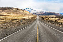 Empty road on the way to Perito Moreno National Park. With some snow mountain in the background. El Calafate, Argentina - Patagonia Royalty Free Stock Image