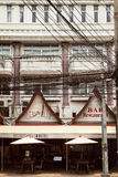 Empty roadside outdoor bar at urban Asian city slum. Pattaya, Thailand - March 28, 2016: Old dirty building exterior on a Thailand town street royalty free stock photo