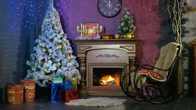 An empty rocking chair beside a Christmas fireplace. New year background. stock footage