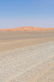 Empty rocky desert road to Erg Chebbi in the Moroccan Sahara, Africa Royalty Free Stock Photos