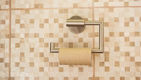 Empty roll of toilet paper in the bathroom. stock photo