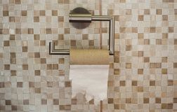 Empty roll of toilet paper in the bathroom. The end concept royalty free stock photos