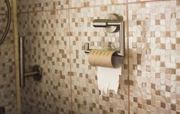 Empty roll of toilet paper in the bathroom. The end concept royalty free stock photo