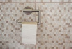 Empty roll of toilet paper in the bathroom. The end concept royalty free stock photography