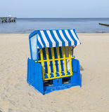 Empty roofed wicker beach chair shot at the beach Royalty Free Stock Photography