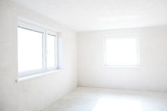 Empty room. Moving in or out - empty room with two windows Royalty Free Stock Photography