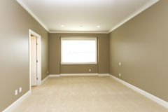 Empty room. Vacant bedroom with neutral walls Stock Images