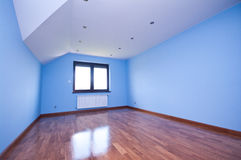 Empty room. Large empty room with shiny wooden flooring Royalty Free Stock Image