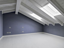 Empty room in the attic. With violet walls and wood ceiling Stock Photos