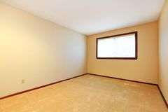 Empty room with beige carpet and window. Stock Image