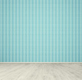 Empty room with blue wallpaper Stock Photography