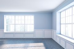 Empty room with blue walls and two windows. Empty room interior with light blue walls, a concrete floor and large windows with a cityscape. A front view 3d Stock Image