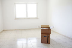 Empty room with boxes stock images