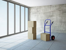 Empty room with boxes and pushcart Royalty Free Stock Images