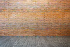 Empty room with brick wall and wood floor Royalty Free Stock Photo