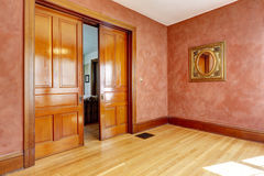 Empty room in bright red color with slide open door Royalty Free Stock Photos