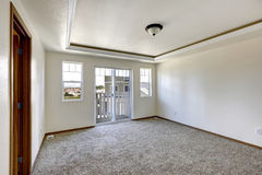 Empty room with brown carpet floor and walkout deck Stock Photo