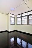Empty room with brown wooden floor Stock Images