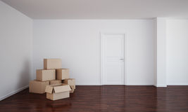 Empty room with cardboard boxes and dark floor Royalty Free Stock Photography