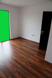 Empty room with chroma key wall. Empty house with door opened, view from indoor, alpha channel Royalty Free Stock Image