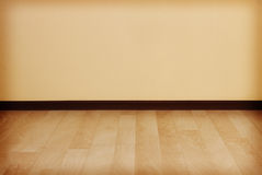 Empty room with clean wall and wooden floor. Royalty Free Stock Photos