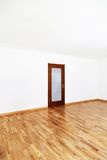 Empty room with closed door Stock Photo
